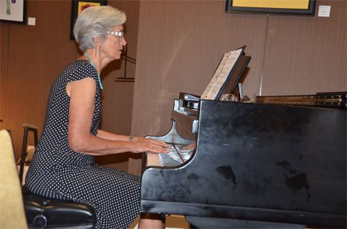 Photo of Dianne's sister playing piano