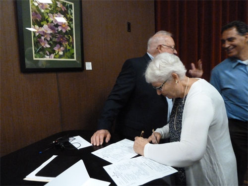 Photo of Bob's sister Alyce Houskamp signing as witness for groom