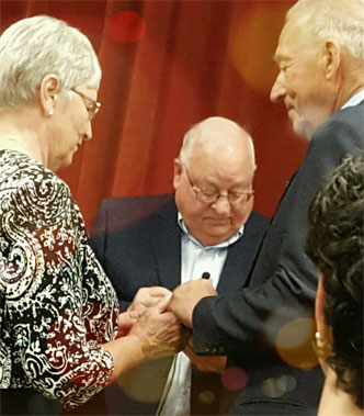 Photo of Dianne and Bob exchanging rings