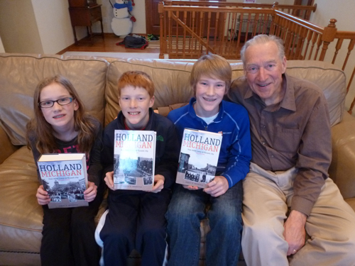 Photo of Robert Swierenga with his grandchildren holding the books