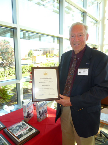 Photo of Robert Swierenga holding plaque for Book of the Year